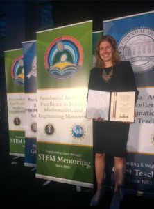 Emily Fischer accepts presidential award for ESWN