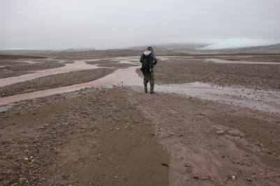 Field work on a glacial outwash plain in Svalbard. Photo by Jun Uetake.