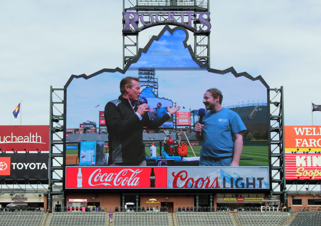 Colorado Climate Center coordinator Noah Newman describes the climate center's mission to Weather and Science Day emcee Steve Spangler and the crowd of 12,000 gathered at Coors Field for the event April 24.