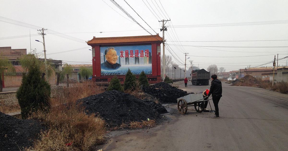 man shoveling coal