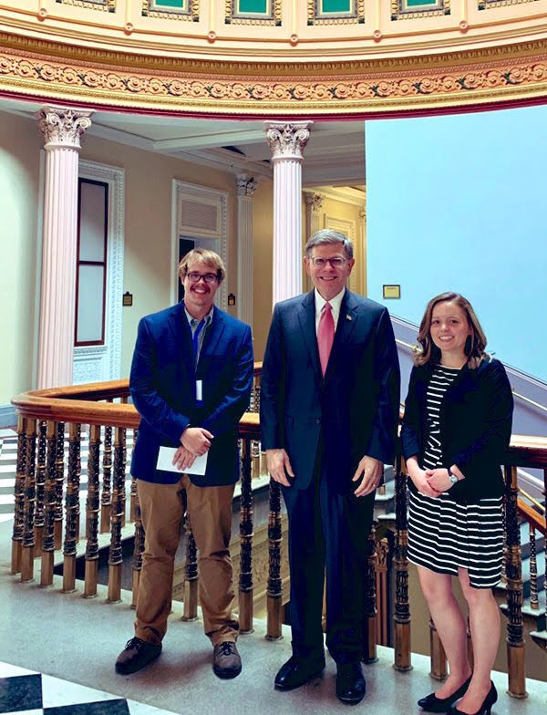 Kate O'Dell and another student from the AMS Policy Colloquium meet with Kelvin Droegemeier, the president's science advisor.