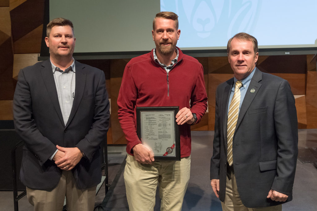Christian Puttlitz with Todd Headley of CSU Ventures and Dean Dave McLean, receiving an award in 2016.