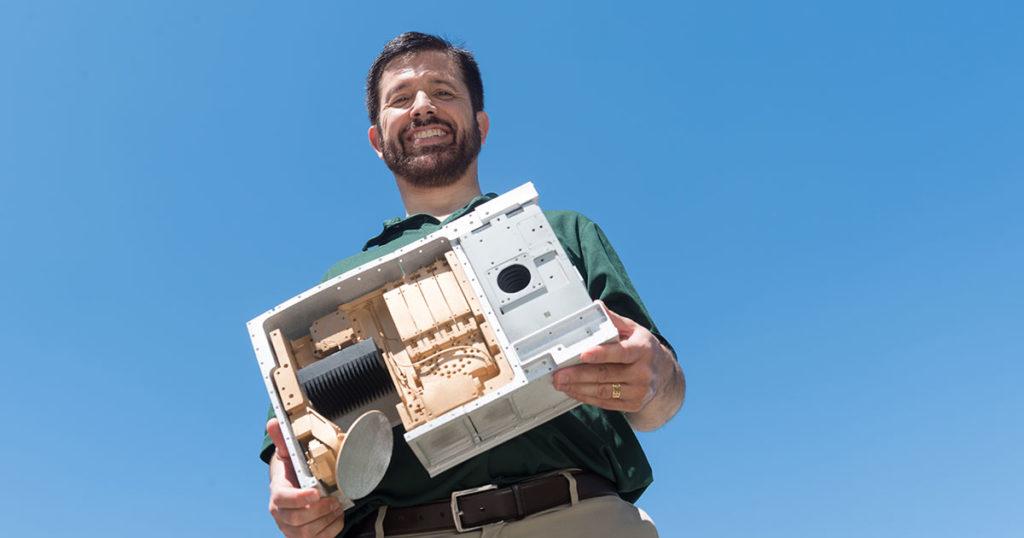 Steve Reising holding satellite model