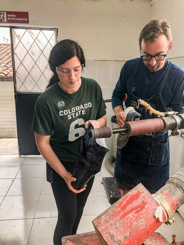 CSU biomedical and mechanical engineering student Brooke Landoch works alongside David Krupa, ROMP co-founder and CEO, to modify a prosthetic device in a clinic in Quito, Ecuador. Photo courtesy Deb Misuraca