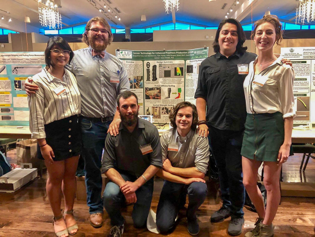 The 2018-2019 senior design team with their poster at E-days 2019. From left to right: Dolly Ricapor, Tyler Parker, David Kimmey, Grant Wulf, Luis Monterrosa, and Jackie Foss. Photo courtesy Ellen Brennan-Pierce