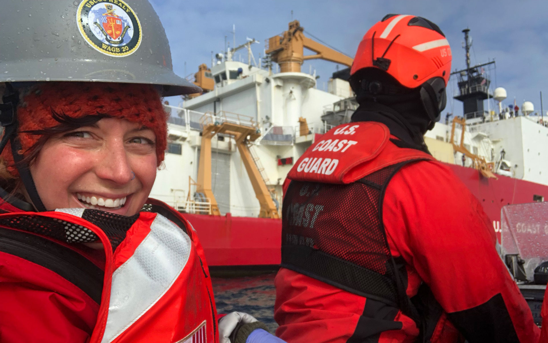 Researcher smiling on board a research ship