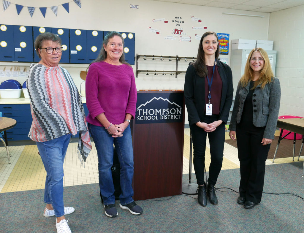From left, City of Loveland Water Quality Manager Ruth Hecker, water quality analyst Sandy Mauer, Thompson School District Director of Operations Kristen Battige, and CSU Department of Civil and Environmental Engineering Professor Pinar Omur-Ozbek were recognized by the EPA on Oct. 11 for TSD's drinking water testing initiative.