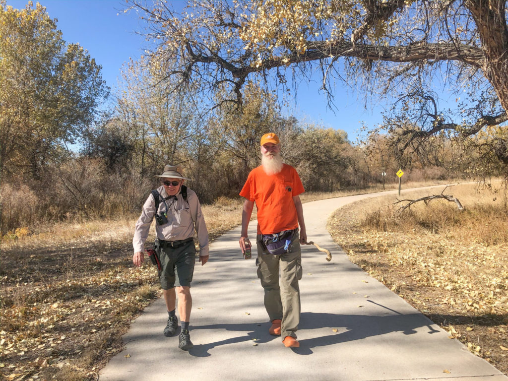 Professor Emeritus William Cotton, left, and Pete Wetzel, his first Ph.D. student, walk the Poudre Trail together as part of Wetzel's goal to hike to every place he has ever lived. Photo by Bill Cotton, Jr.