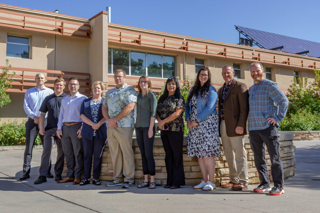 Members of the Department of Systems Engineering staff and faculty pose in front of the CSU Engineering Building, fall 2019