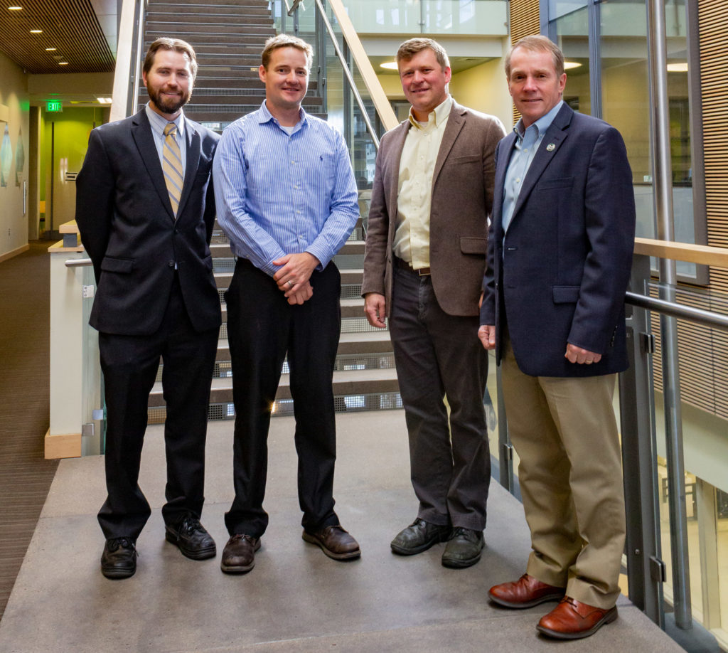 Professors Jesse Wilson, Jason Quinn and Tom Bradley, head of Systems, with Dean Dave McLean