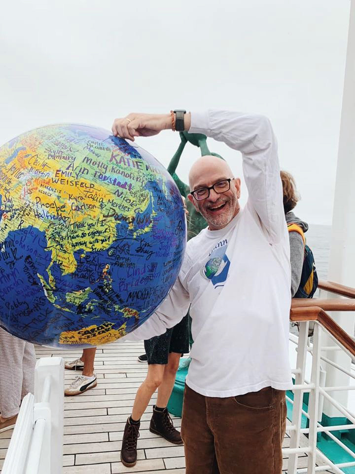 Students left their marks on the world, in the form of an inflatable globe held by Professor Scott Denning on the Spring 2020 Semester at Sea voyage.
