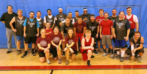 Justin Whitaker, standing at right in solid red, participates in a 2019 ARO basketball game, along with atmospheric science students Rick Schulte, Emily Bell and Sean Freeman.