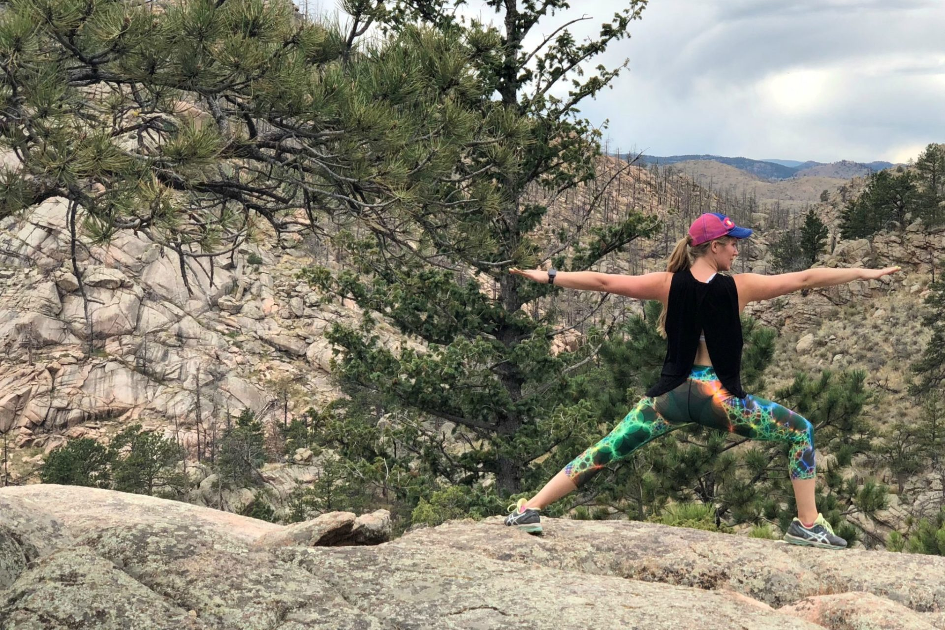 Toni-Lee Viney does a Warrior II pose at Grey Rock