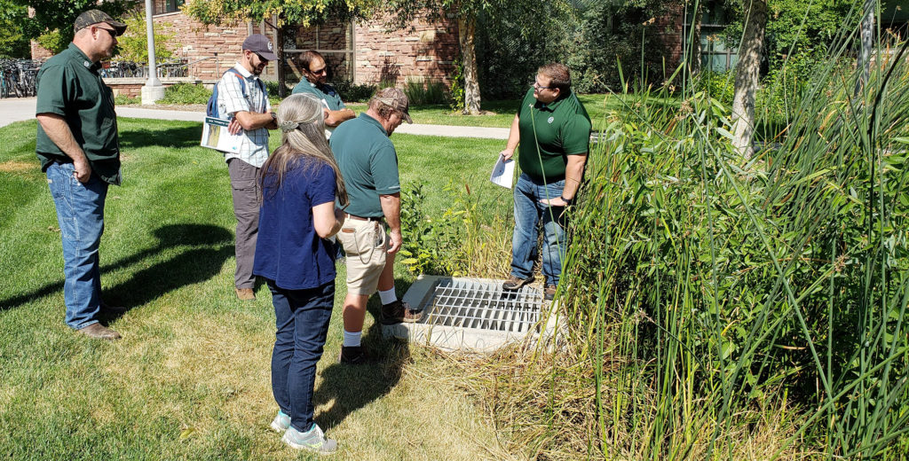 Colorado Stormwater Center director Tyler Dell explains a stormwater feature to a seminar group on the Colorado State University Fort Collins campus, September 2019.