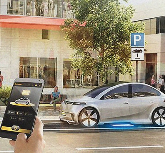 A hand holding a smart phone that controls an electric vehicle