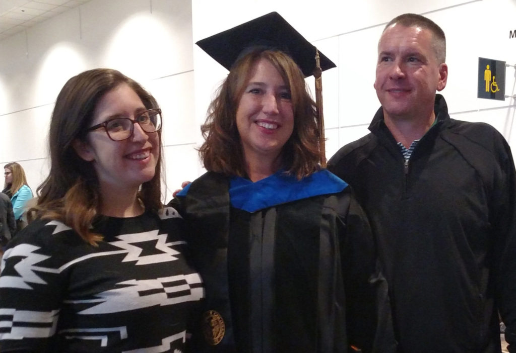 Nicole Ellison, pictured with her daughter, left, and husband, right, returned to school for her graduate degrees when her daughter went to college.