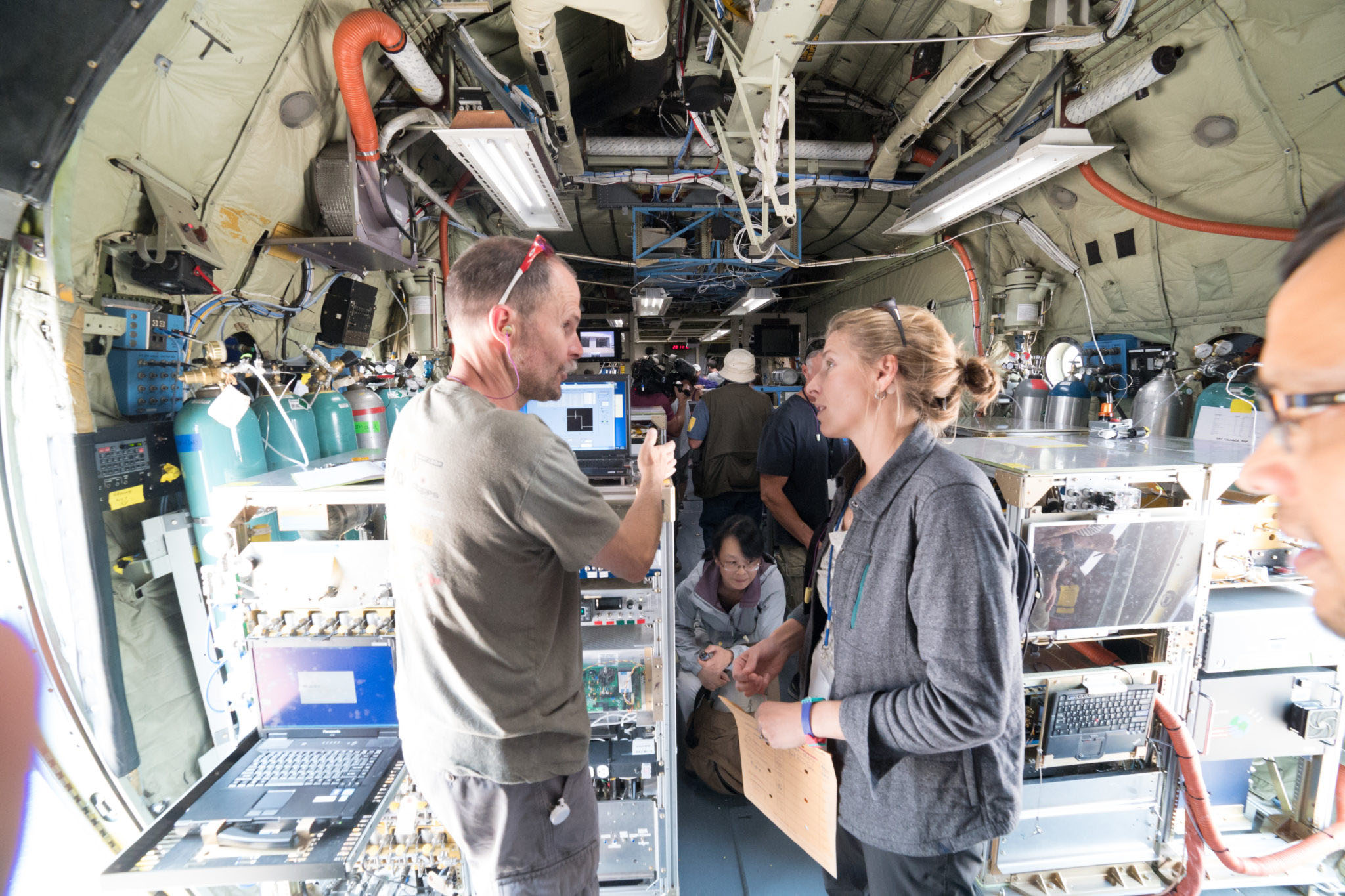 WE-CAN scientists Frank Flocke, Emily Fischer and other collaborators aboard the NSF/NCAR C-130, loaded with instrumentation for studying wildfire smoke.