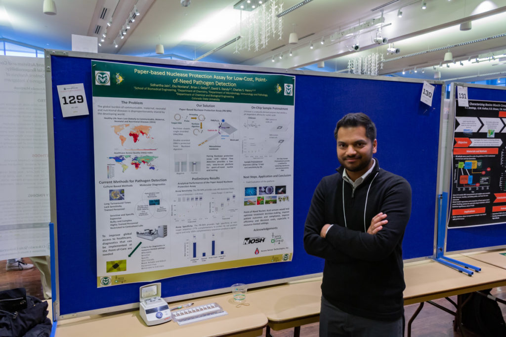 School of Biomedical Engineering graduate student Sid Jain stands at his display during the 2019 Graduate Student Showcase.