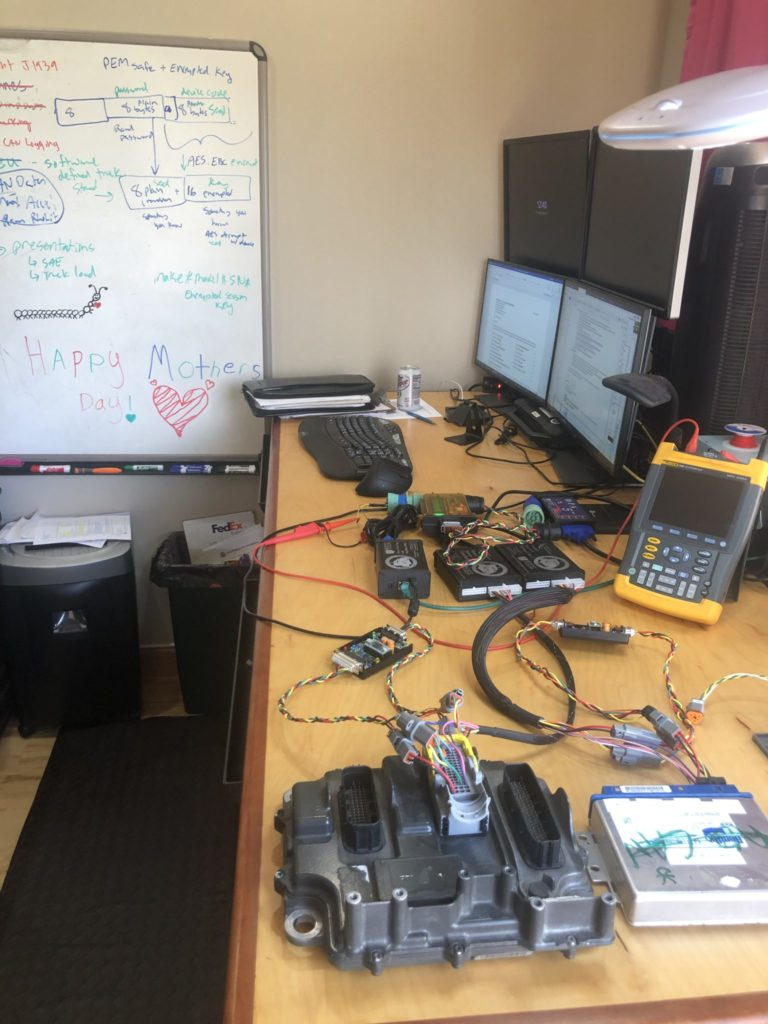 Heavy vehicle electronic control units (ECUs) sitting on the desk of CSU associate professor in systems engineering Jeremy Daily.