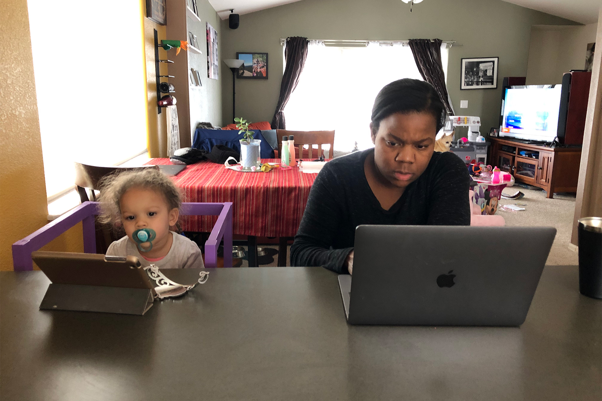 Melissa Burt and daughter at their computers