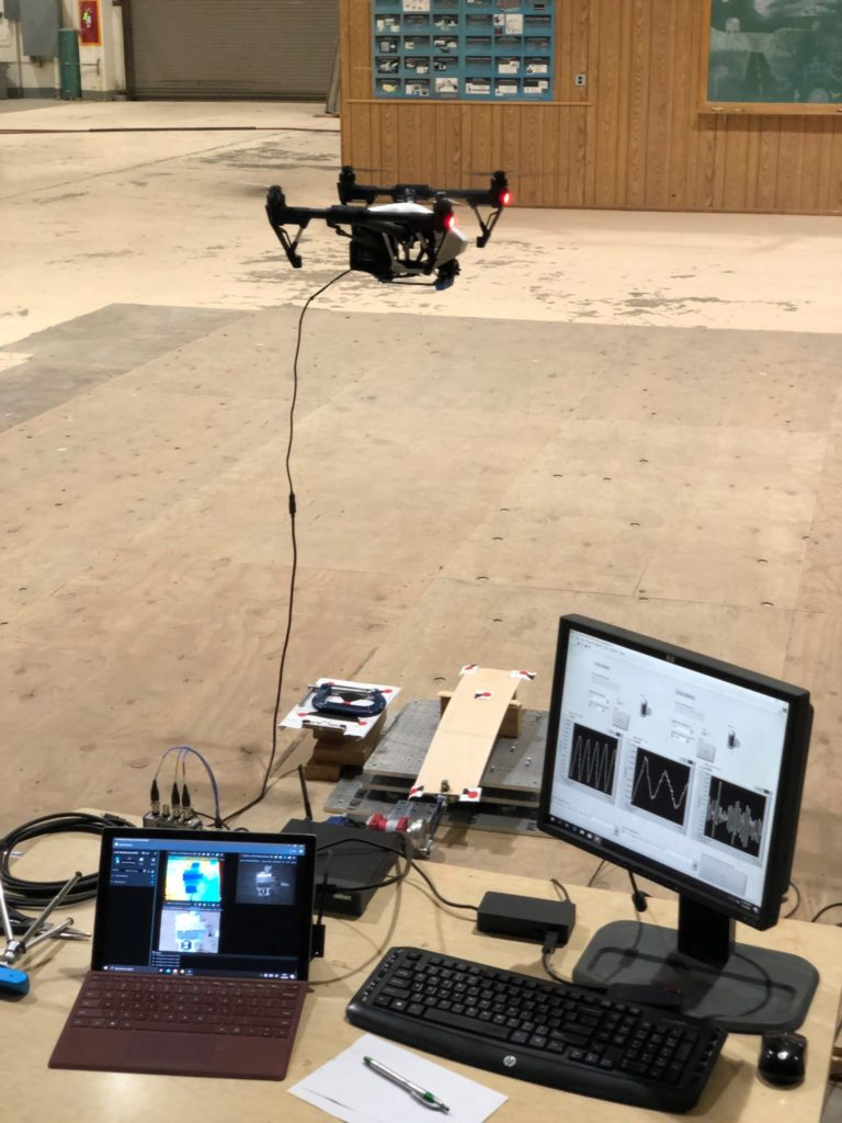 Guo and Perry used a drone equipped with a RealSense sensor to measure the dynamics of a vibrating cantilever on a shake table at the Engineering Research Center. Chris Robertson piloted the drone.