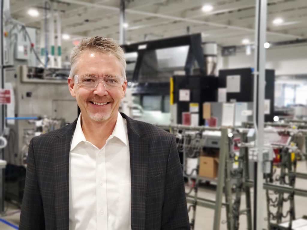 Roger Ross on the manufacturing floor at Woodward's Drake campus.