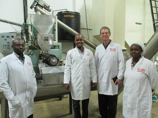 Dave Cummings, Chemical and Biological Engineering alumnus, with the staff of a food processor in Nairobi called Soy Afric.