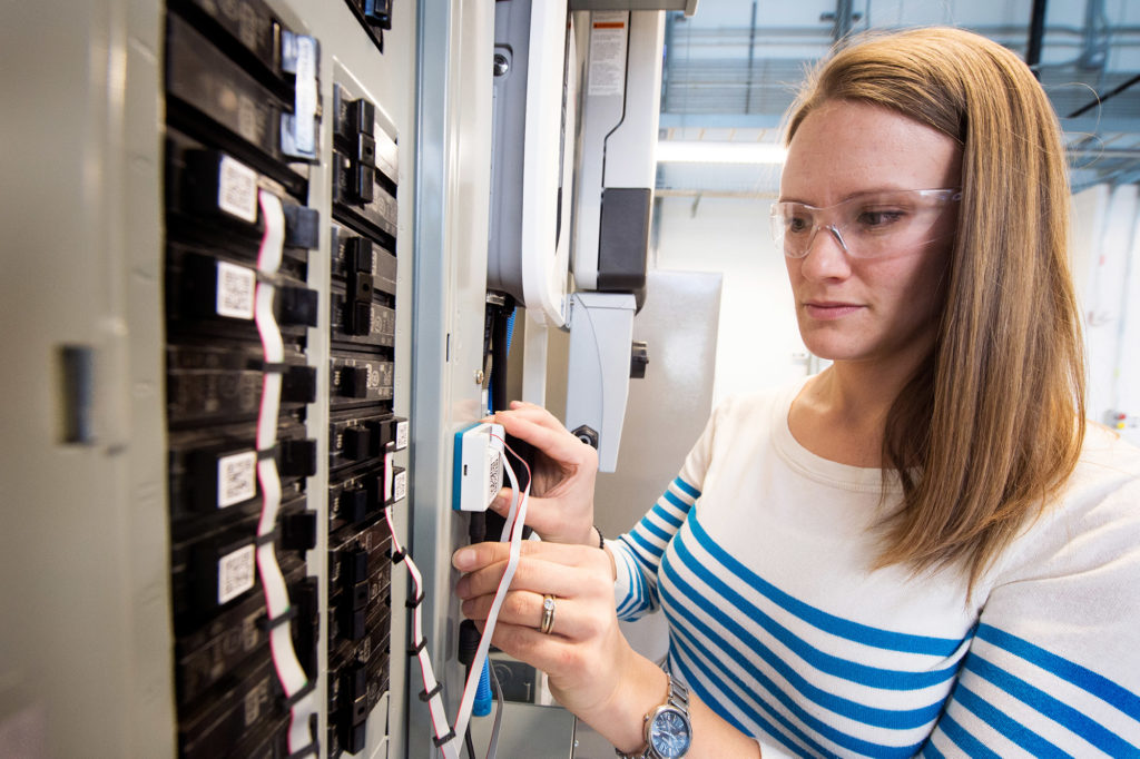 Sparn works on a new type of nonintrusive power meter at NREL. Photo credit: Dennis Schroeder