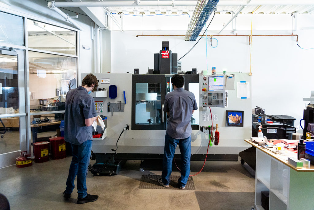 Photo of students working in the Colorado State University Powerhouse Energy Campus.