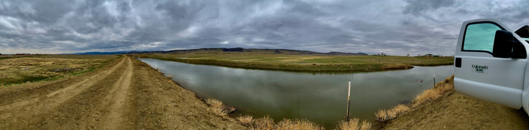 A panoramic photo of an irrigation canal in Larimer county
