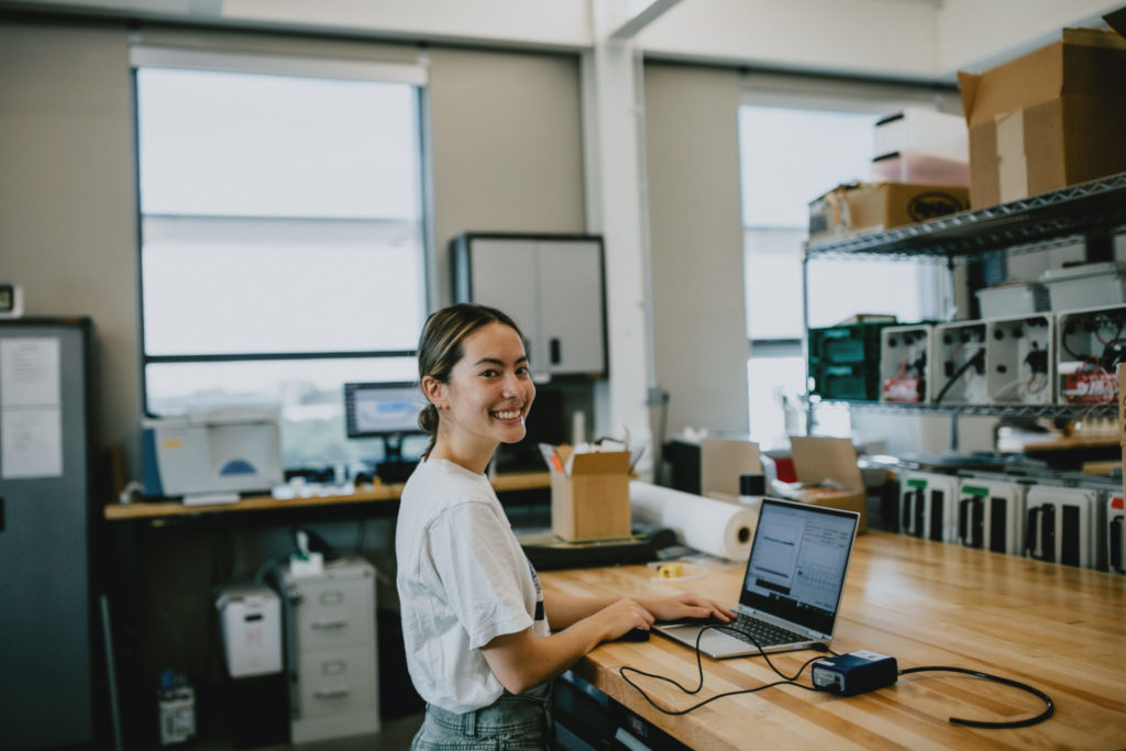 A summer research intern at the computer in her laboratory