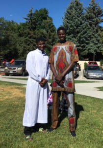 Ousman Ba and Djibril Diol pictured in formal attire for an Eid celebration