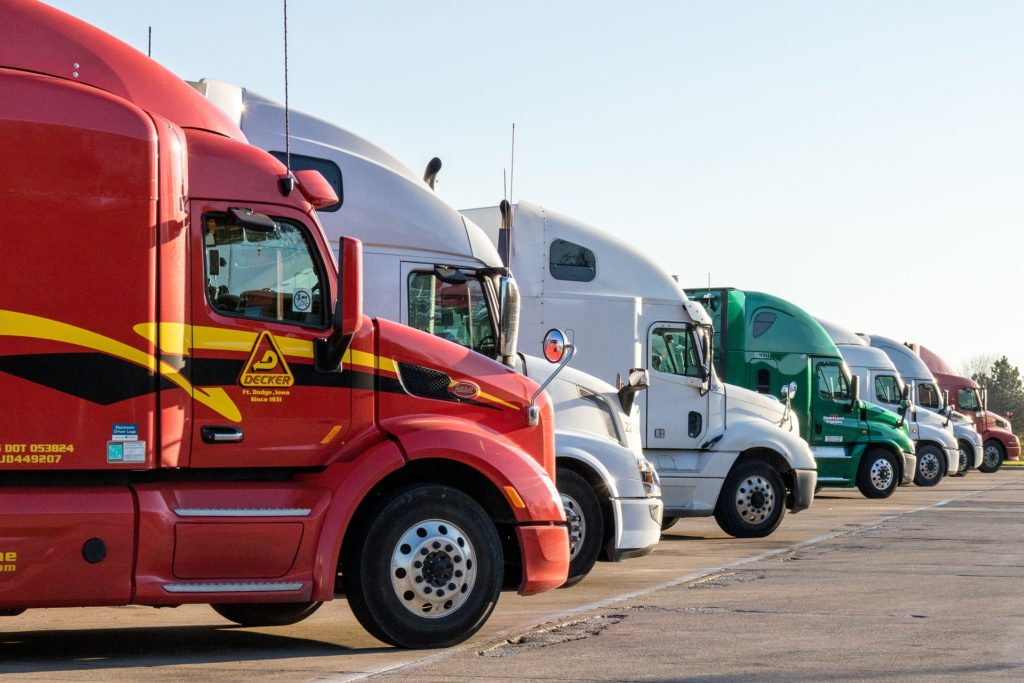 A row of parked tractor trailers