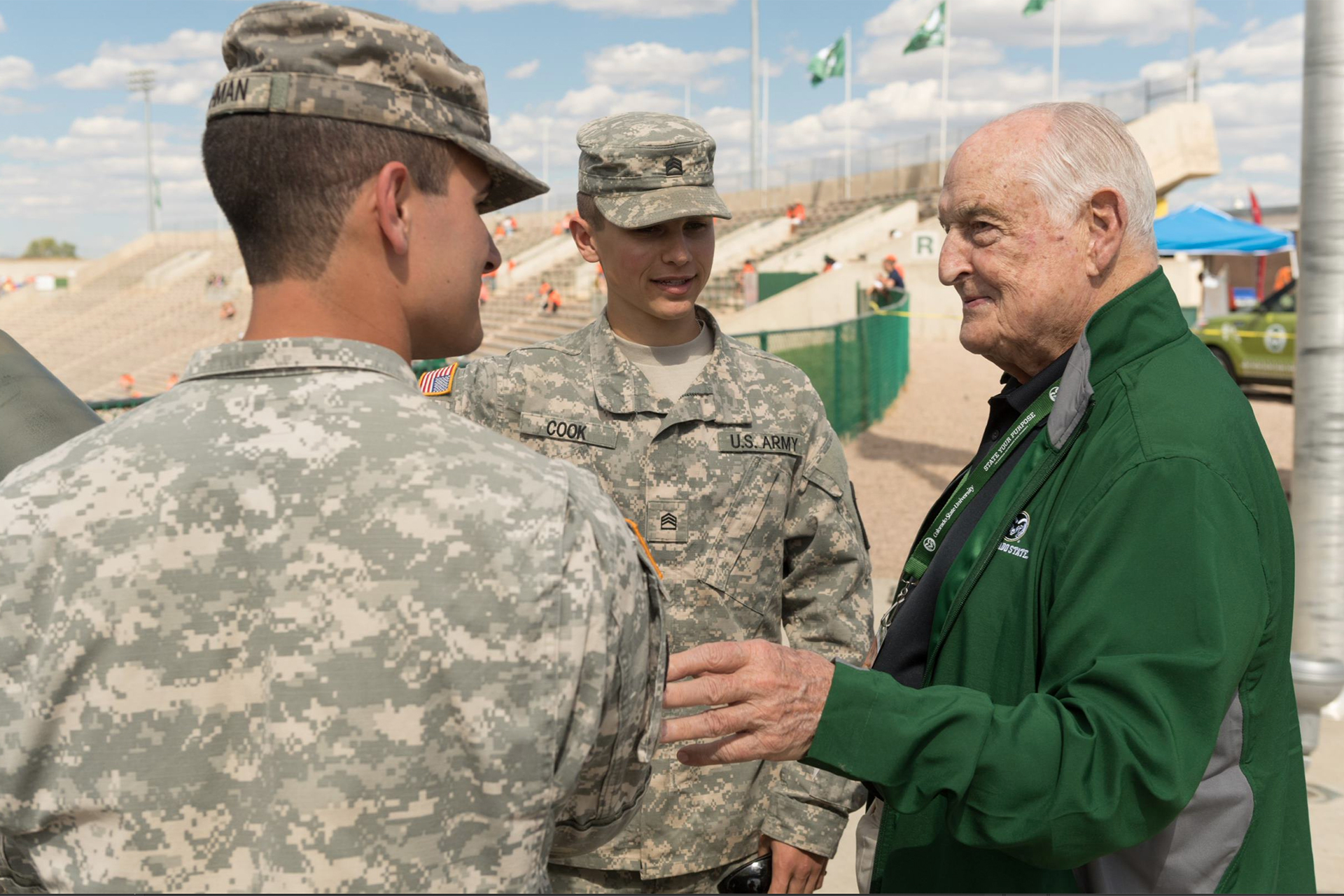 Walter Scott, Jr. at CSU football game with ROTC cadets